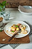 Gnocchi with a creamy mushroom sauce, bacon and sage