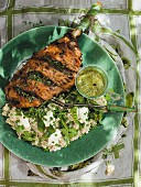 A leg of lamb with peas and risotto