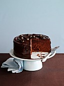 A chocolate Angel Cake on a cake stand, sliced