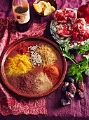 Moroccan spices - Saffron, ground cummin, ground coriander, ground sumac, pomegranate, preserved lemon, dates, Fresh mint leaves