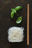 Rice vermicelli, basil and chopsticks