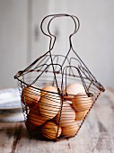 Brown hen's eggs in a wire basket
