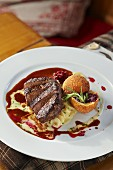 Roasted saddle of veal with black salsify ragout and baked red cabbage dumpling (Austria)