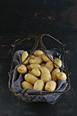 New potatoes in a wire basket