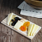 A cheese platter with dried fruits