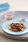 Pancakes with banana and caramel sauce