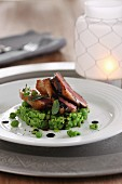 Smoked roast pork on peas with balsamic sauce
