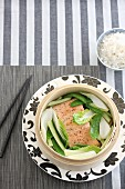 Steamed salmon with bok choy, spring onions and mange tout