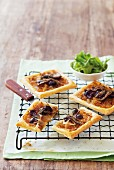 Pizza slices with black olives and anchovies