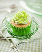 A citrus cupcake with green sugar