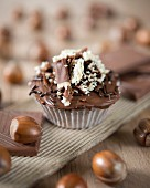 A chocolate cupcake with hazelnuts
