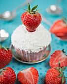A strawberry and coconut cupcake