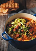 Kale soup with beans, potatoes and bacon