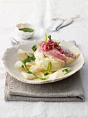 Lime-steamed red mullet fillet with mint salsa verde on roasted kohlrabi slices and sour cream mashed potatoes