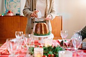 A woman serving dessert at a family Christmas party
