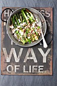 Grilled green asparagus with feta cheese and balsamic vinegar