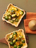 Brussels sprouts quiches with a mustard and Cheddar cheese sauce