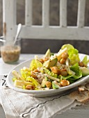 Cheese salad with Senner cheese, avocado and caramelised macadamia nuts in a pear dressing