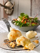 Cheese doughnuts with a green salad