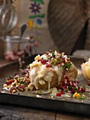 A baked potato with cheese and beetroot