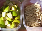 Diced pears and toothpicks for tasting at a market