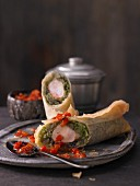 Spring rolls with braised savoy cabbage with saddle of rabbit fillet and a spicy pepper dip