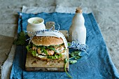 Salmon burger with wasabi sauce