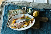 Soused herring fillets with a pear and pumpkin salad and dill butter