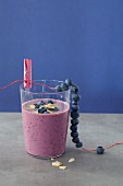 A blueberry shake with flaked almonds