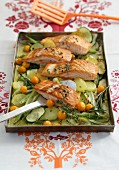 Oven roasted salmon with vegetables and physalis
