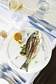Grilled sea bream with potatoes, garlic and lemon