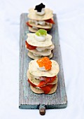 Herb crackers with cream cheese, vegetables and caviar