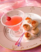 Cream cheese balls served with a cocktail
