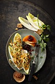 Raw parsnips and carrots on chicory with baked Camembert