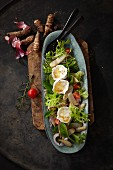Fried Jerusalem artichokes with goat's cheese on a bed of lamb's lettuce