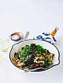 Homemade fettucine with prosciutto, mushroom and parsley