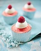 Pink velvet cupcakes with raspberries
