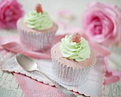 Strawberry cupcakes decorated with mint cream and jelly tots