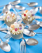 White chocolate cupcakes decorated with sweets