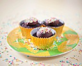 Dark chocolate cupcakes with colourful sugar sprinkles