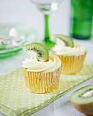 Fruity cupcakes with kiwi frosting and slices of kiwi