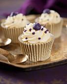 Vanilla cupcakes with blackcurrant cream
