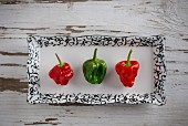 Three Scotch Bonnet chilis (seen above)
