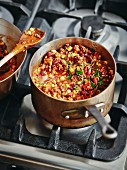 Chilli con carne in a copper pan on a stove