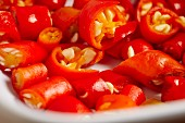 Sliced red chilli peppers (close-up)