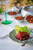 Tomato aspic with a lettuce leaf on a plate