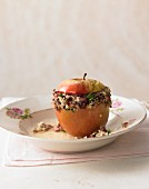 A spiced baked apple with black pudding, couscous and loveage