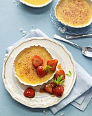 Woodruff crème brûlée with roasted strawberries