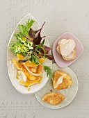 A summer salad with melon and baked Camembert