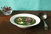 Cold pea soup with ice cubes